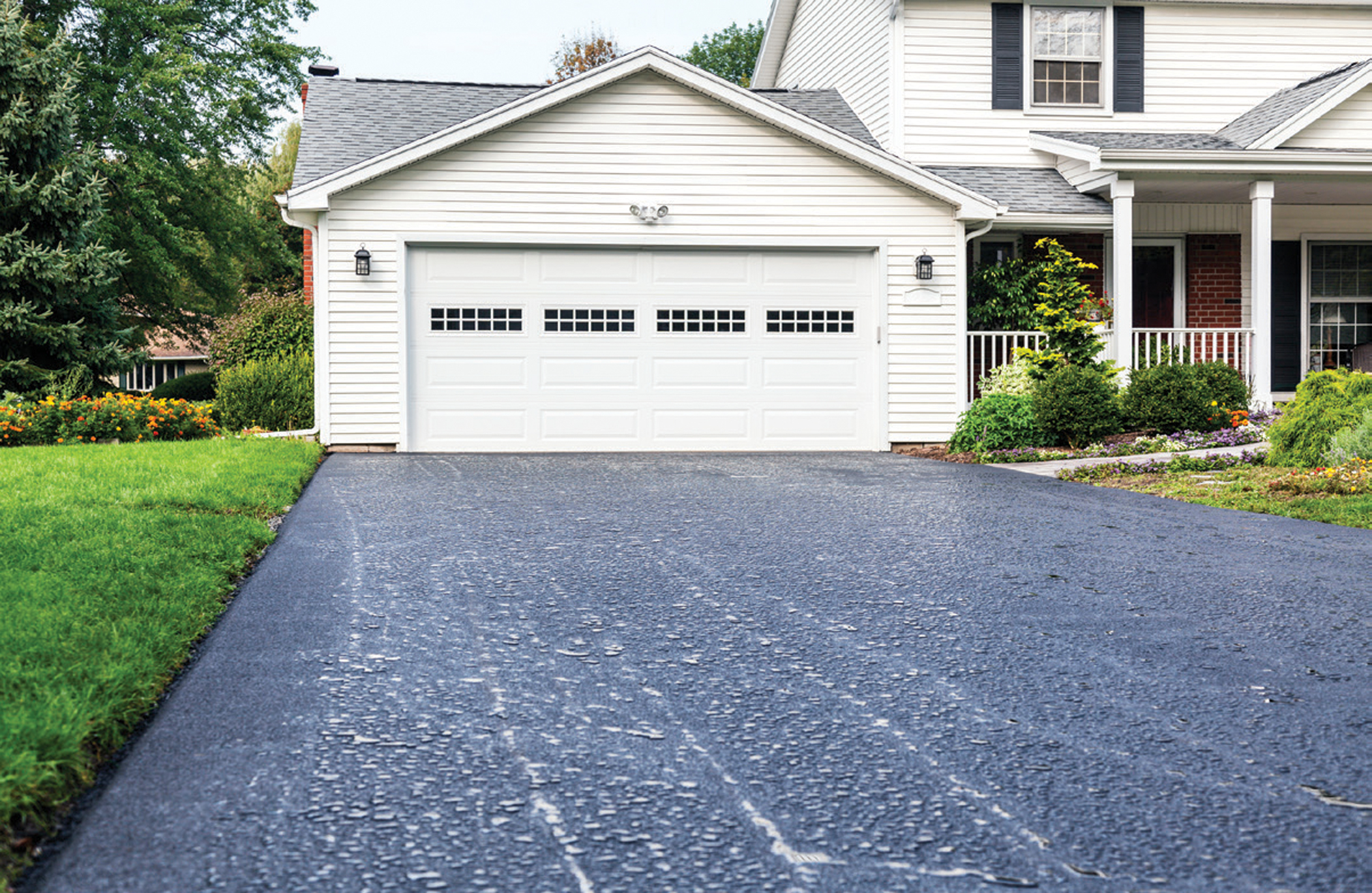 New Asphalt Driveway Rain Puddles at Residential Home
